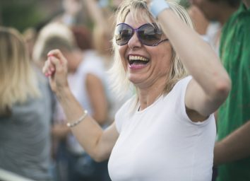 Mature woman enjoying music concert.