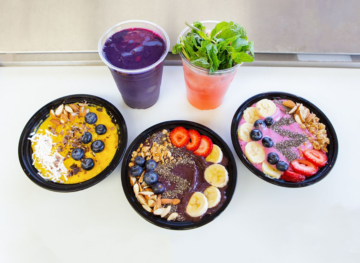 three smoothie bowls and two juices