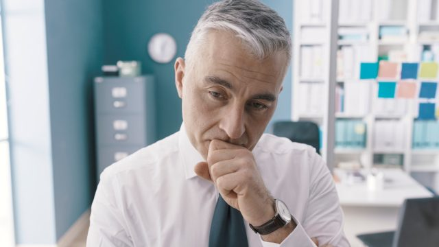 Pensive,Concerned,Businessman,Standing,In,His,Office,And,Thinking:,Business