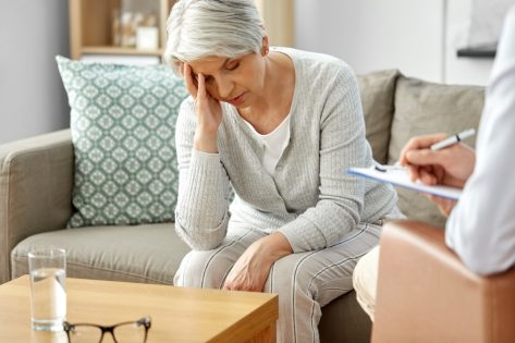 Unhappy senior woman patient and psychologist