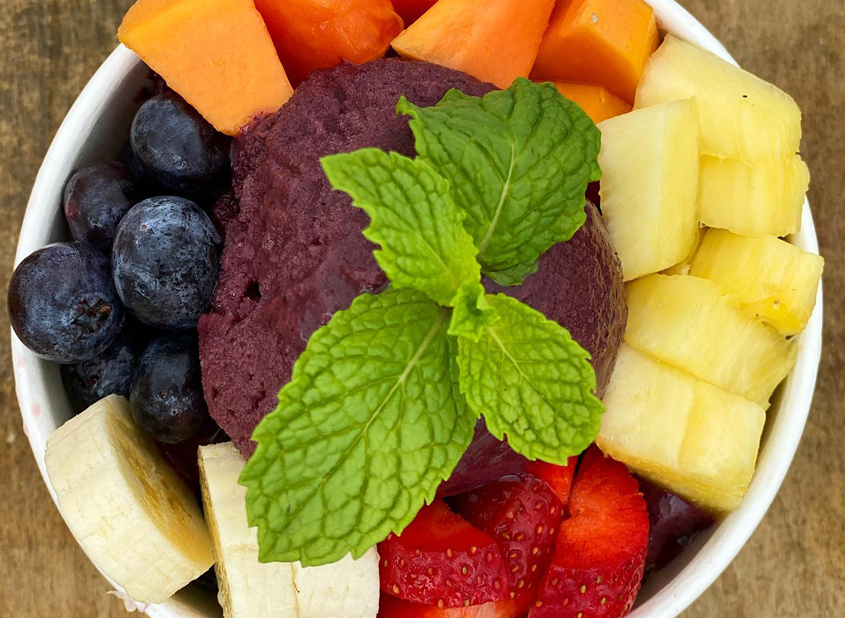 smoothie bowl topped with fresh fruit