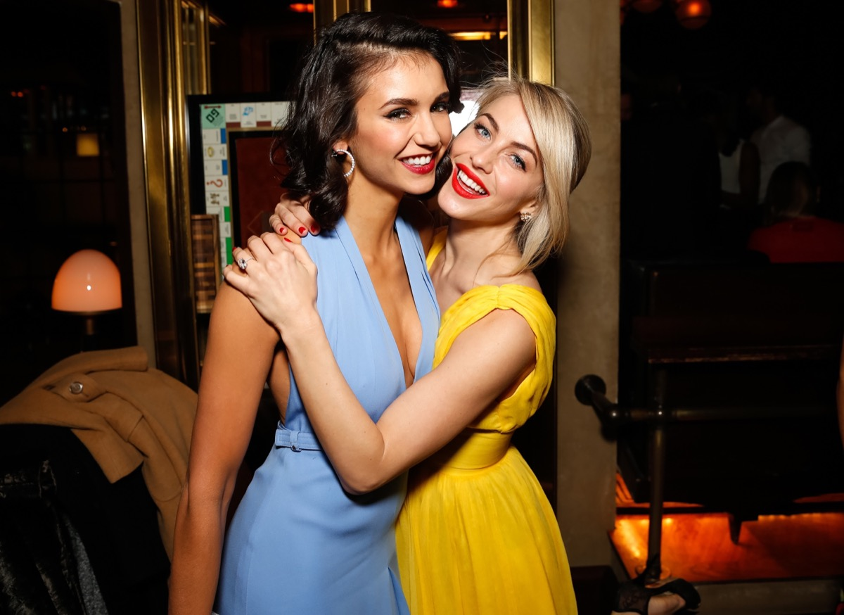 nina dobrev and julianne hough embracing