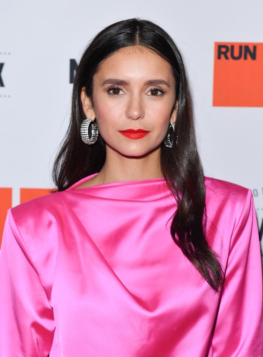 nina dobrev in pink dress on red carpet