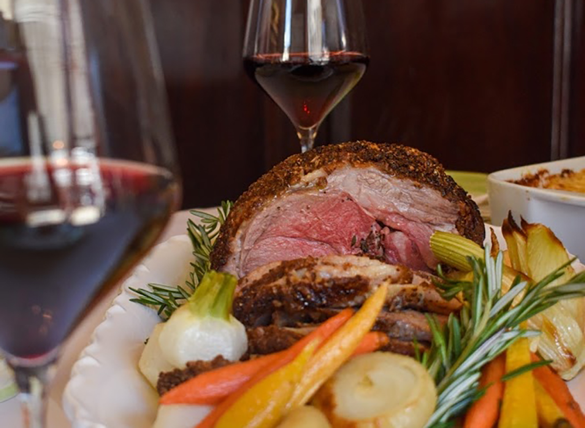 filet mignon roast with vegetables and wine glasses