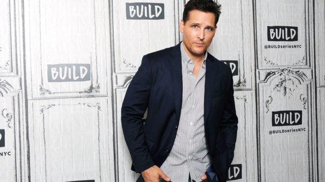 peter facinelli in black jacket and gray button-down