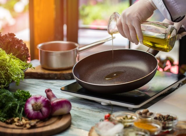 person pouring oil into nonstick pan