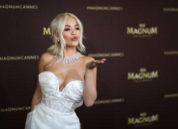 rita ora in white dress blowing kiss