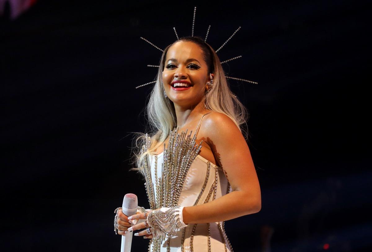 rita ora wearing rhinestone bustier and star crown