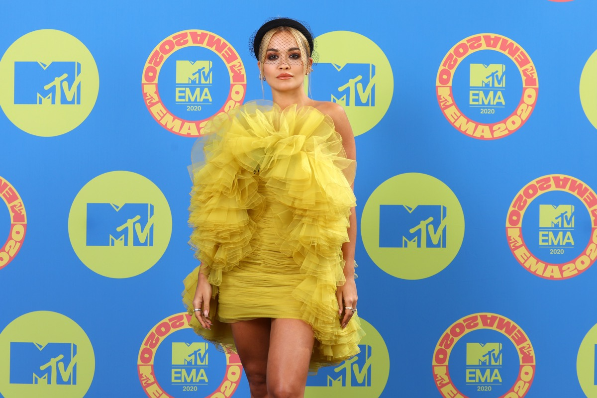 rita ora in yellow ruffled dress on red carpet