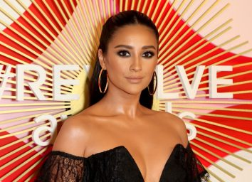 shay mitchell in black off-the-shoulder dress on red carpet