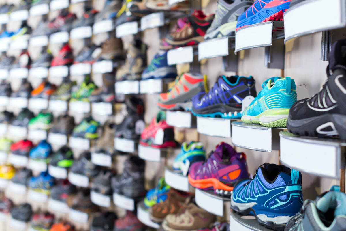 Image of shelves of the store with sport shoes.