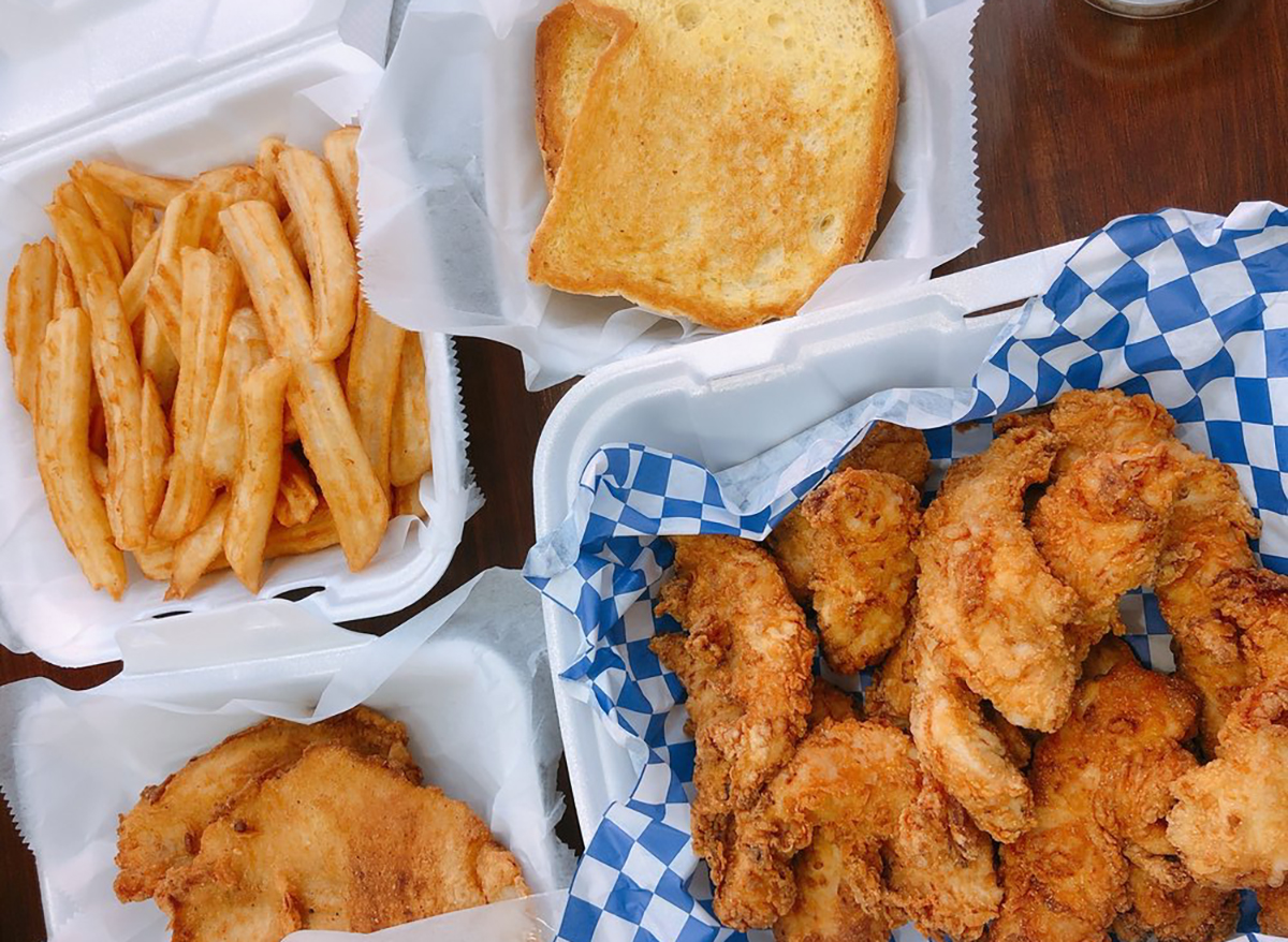 plates of chicken and fries