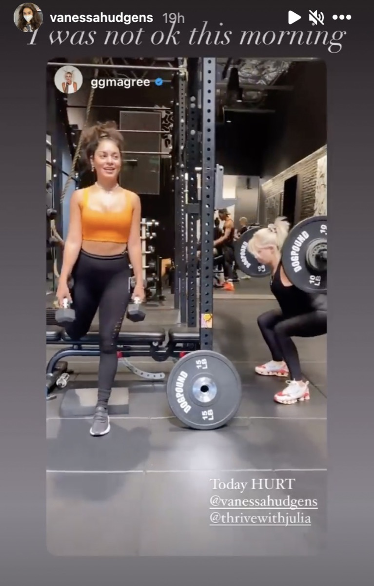 vanessa hudgens and a friend doing weight based workouts in a gym