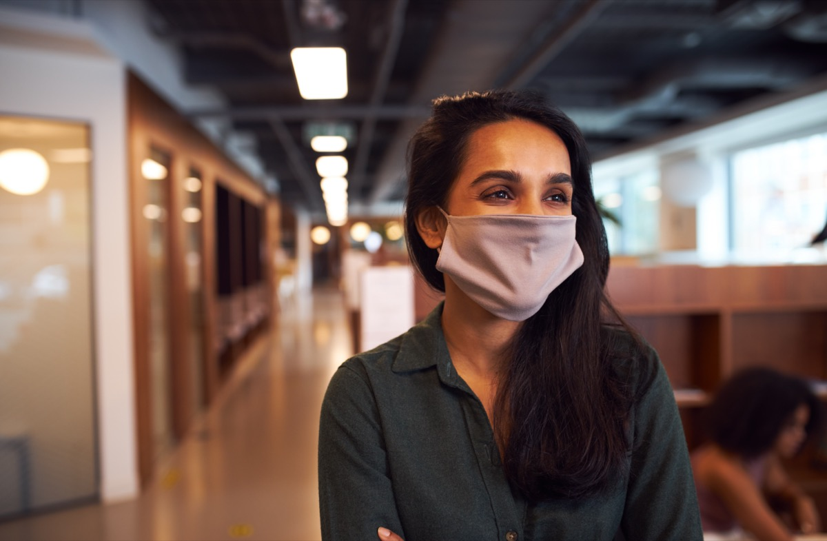 businesswoman wearing face mask in office.