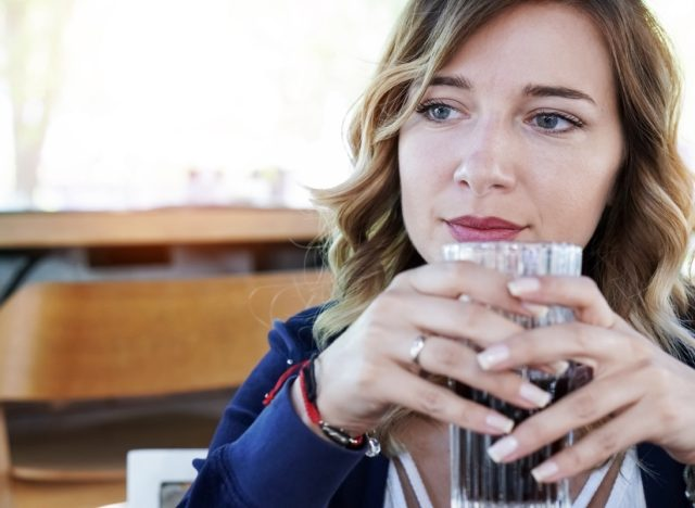 Woman drinking soda outdoors