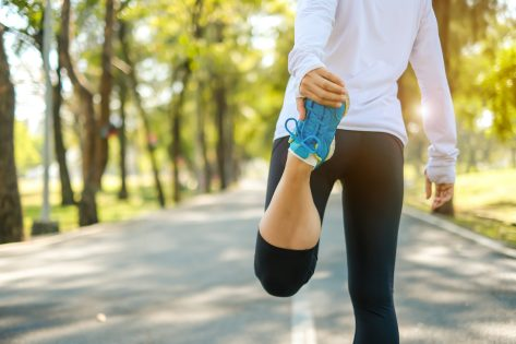 young fitness woman legs walking in the park outdoor, female runner running on the road outside, asian girl jogging and exercise on footpath in sunlight morning. healthcare and well being concepts