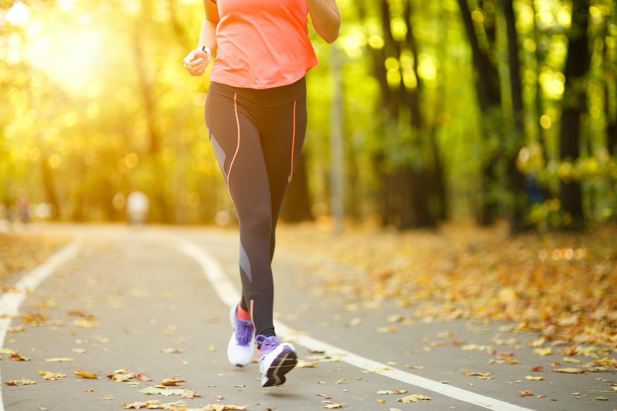 Woman exercise walking outdoors, shoes closeup