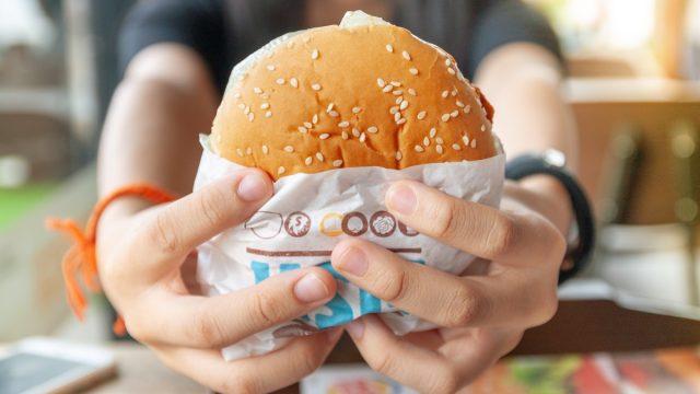 person holding burger king burger