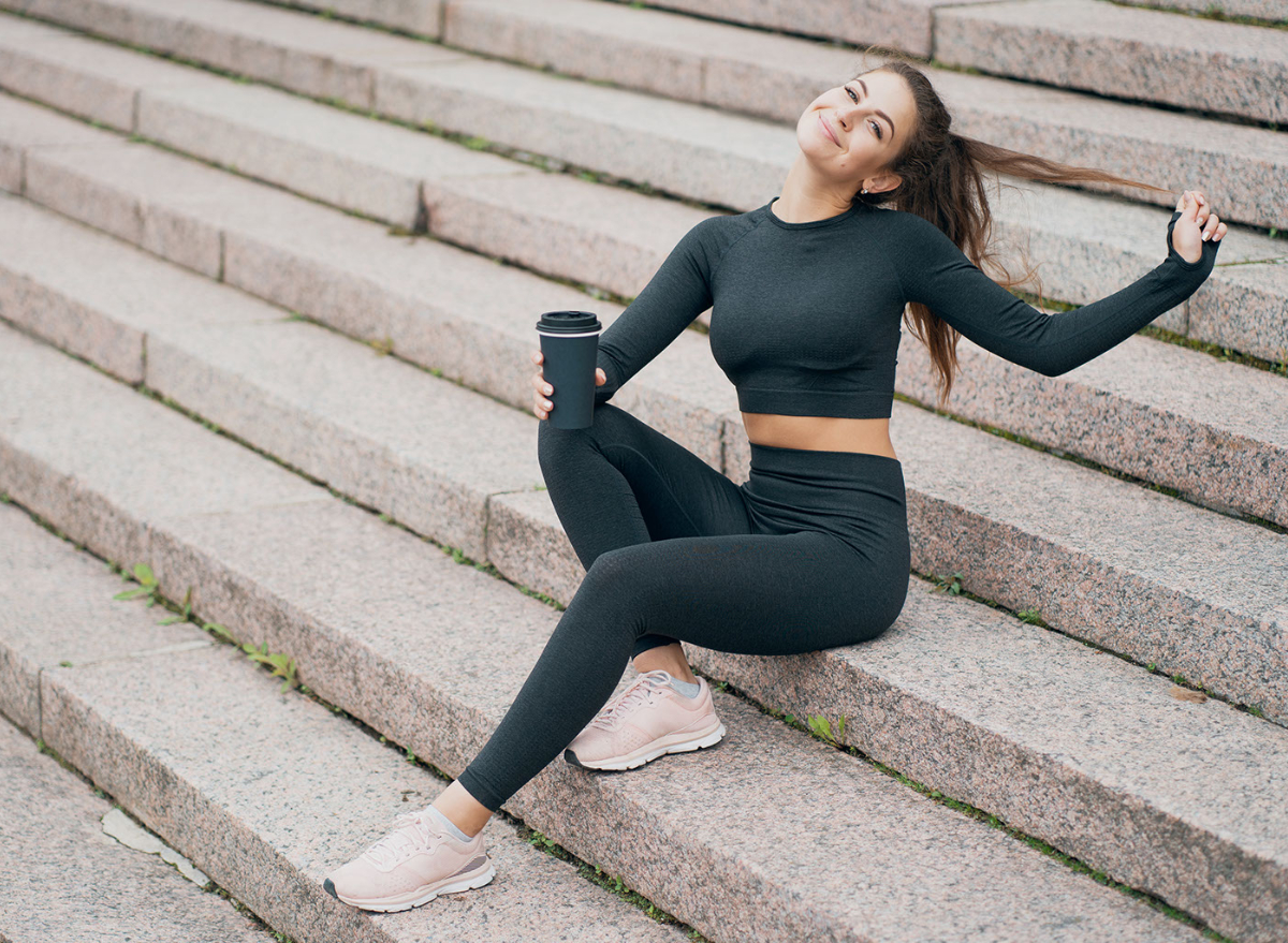 woman drinking coffee on stairs