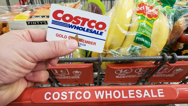 costco card and cart with groceries