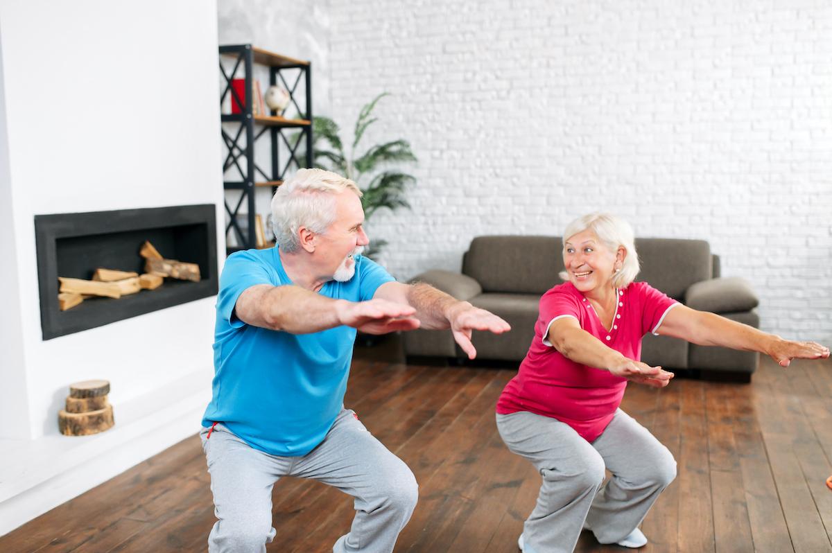 elderly couple squats