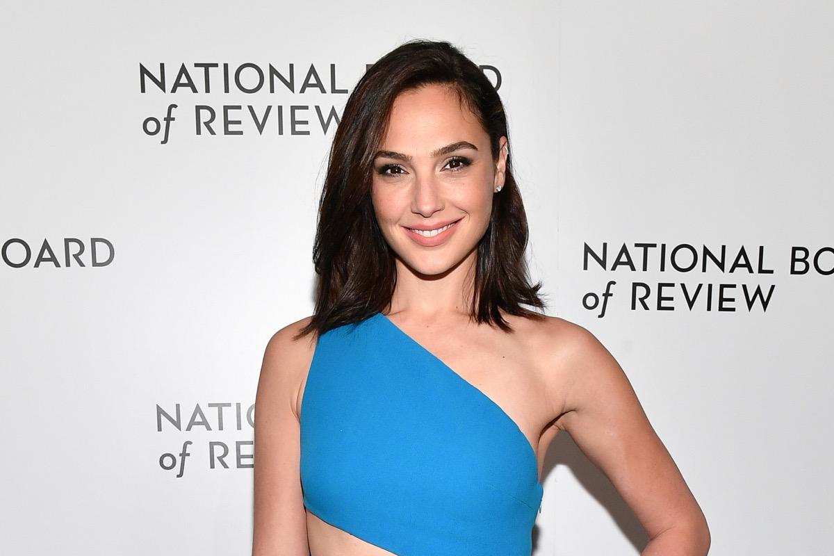 gal gadot smiling in blue one-shoulder dress
