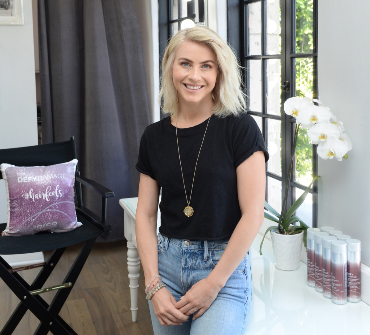 julianne hough smiling in black shirt and jeans