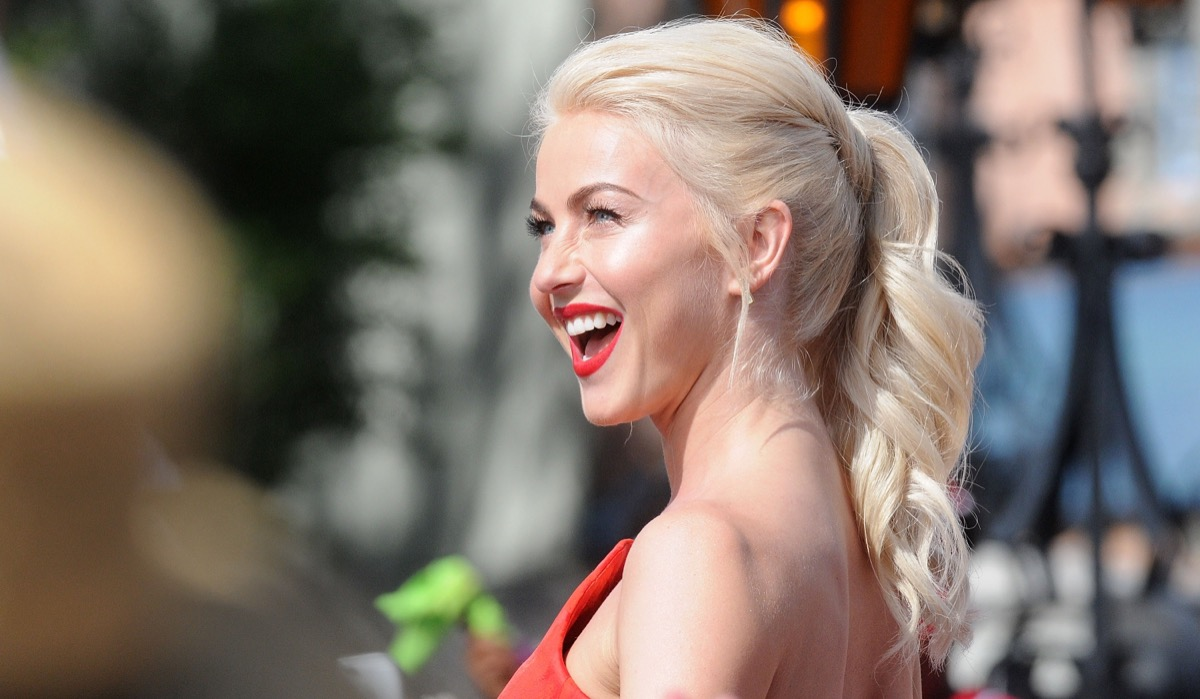 juliane hough smiling outdoors in red dress