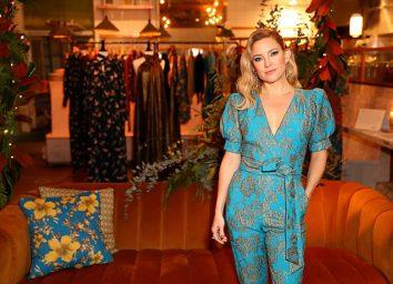 kate hudson in blue jumpsuit in clothing showroom