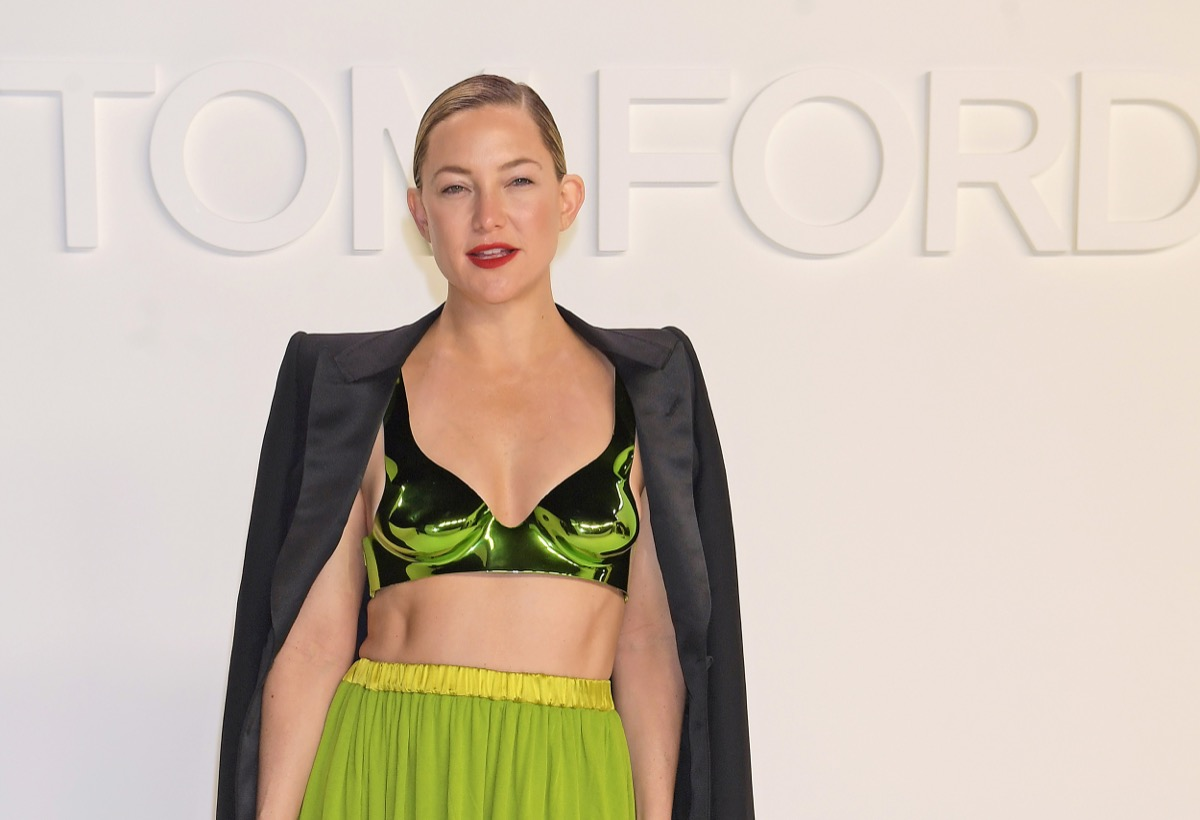 kate hudson in crop top and yellow skirt on runway