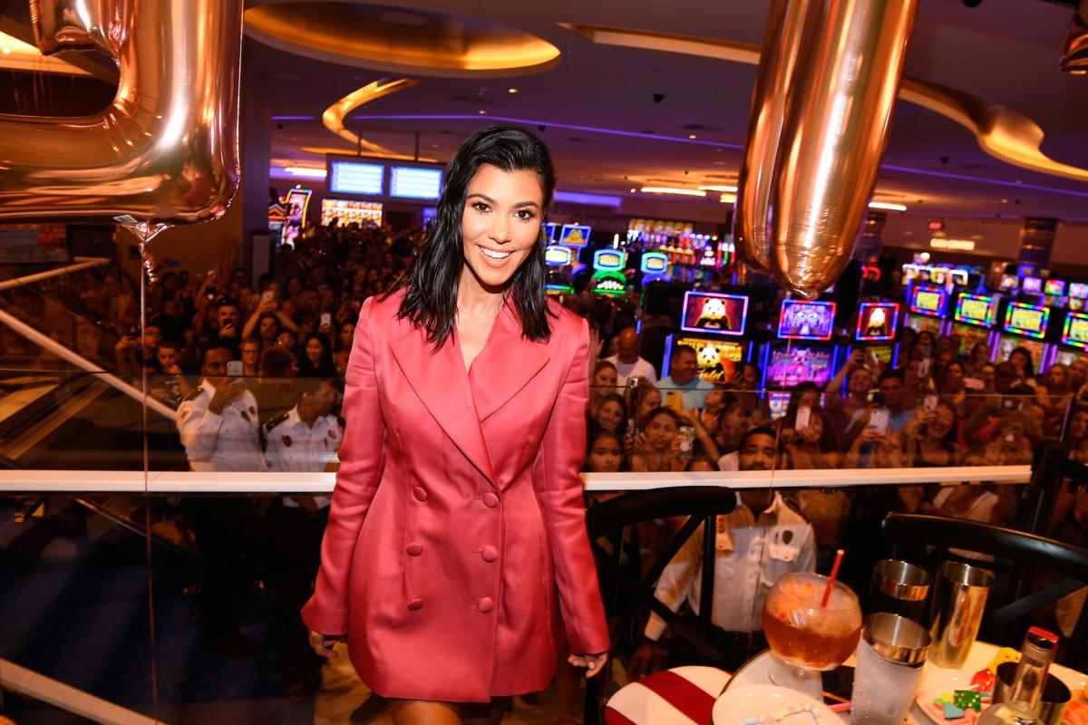 kourtney kardashian in red suit at restaurant