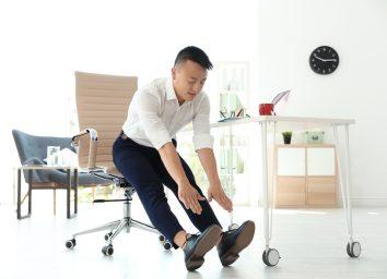 man exercising at his desk