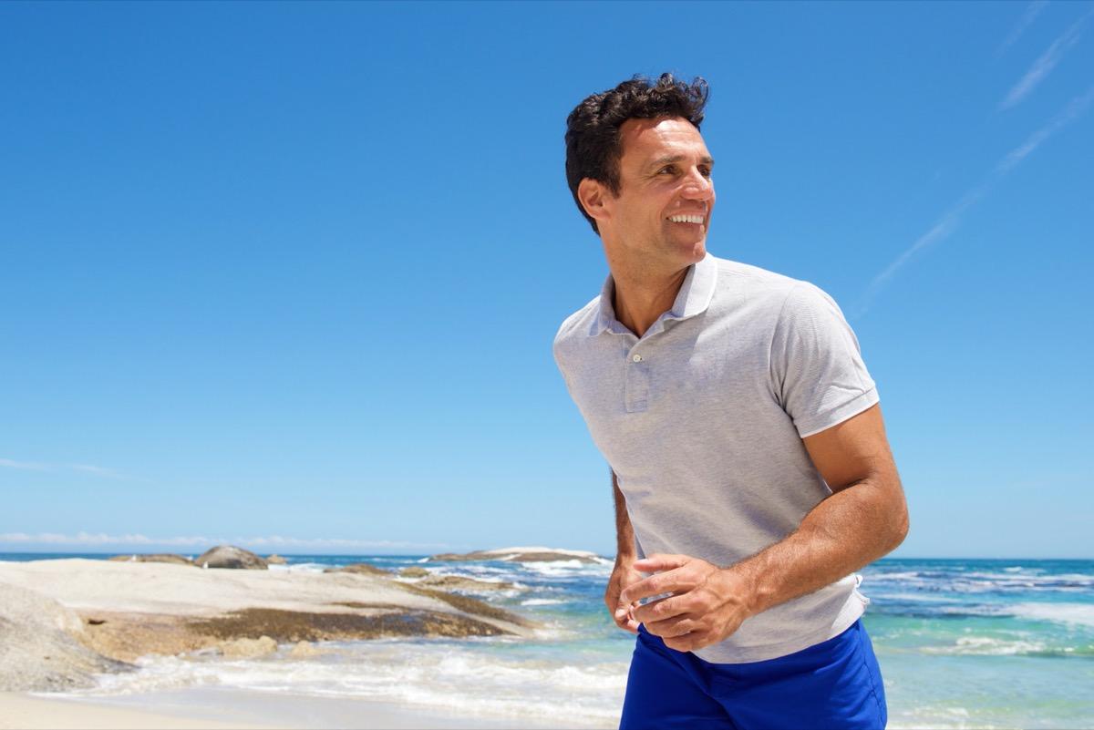 happy man walking on the beach