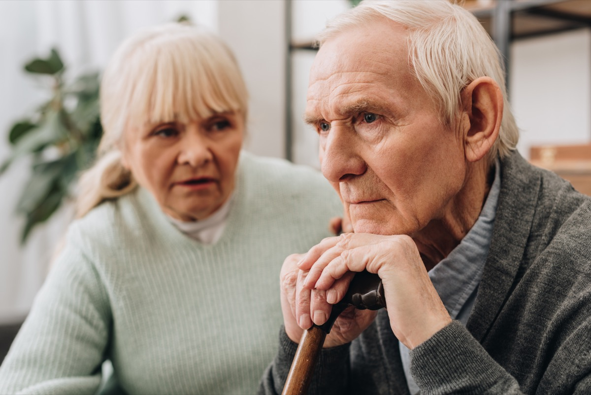 older man with dementia sitting next to wife