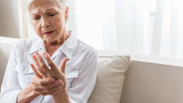 older woman with hand pain