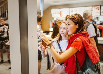 women ordering fast food on electronic menu