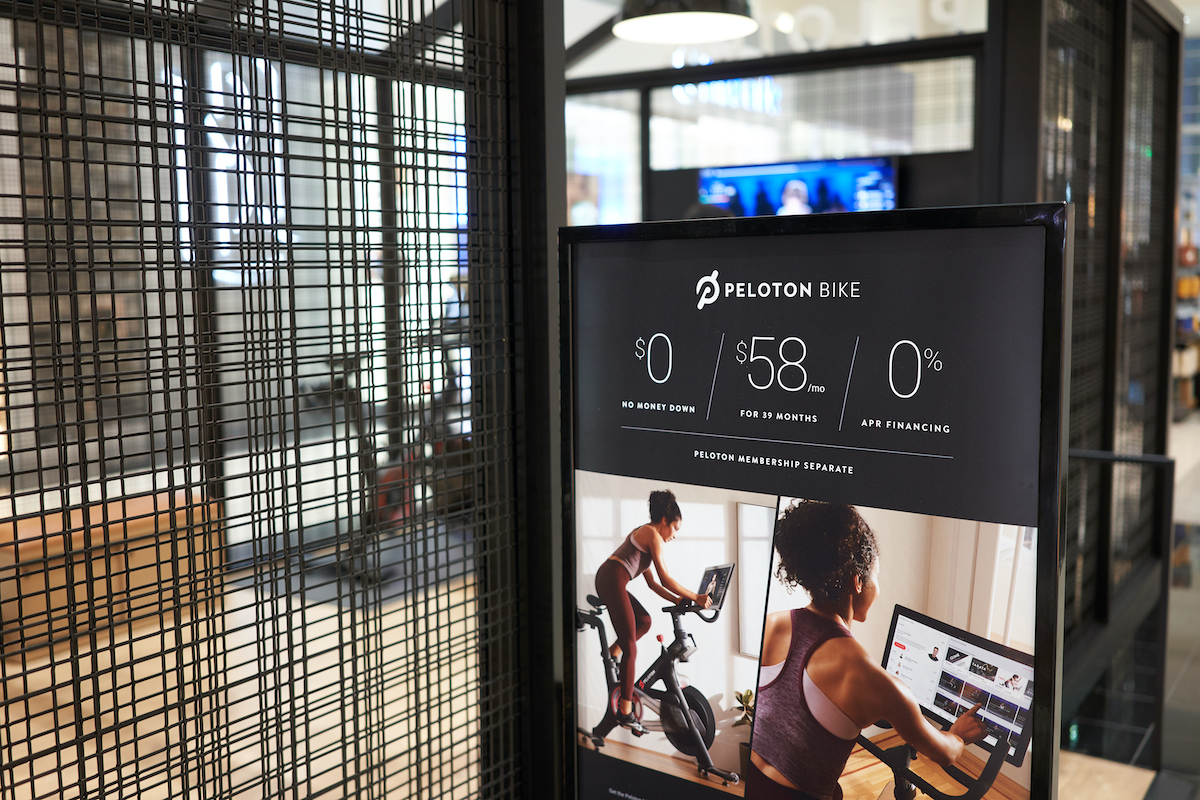 Tigard, Oregon, USA - Sep 28, 2019: Peloton bike monthly payment plan advertisement is seen outside a Peloton showroom in Washington Square Shopping Center in Tigard.
