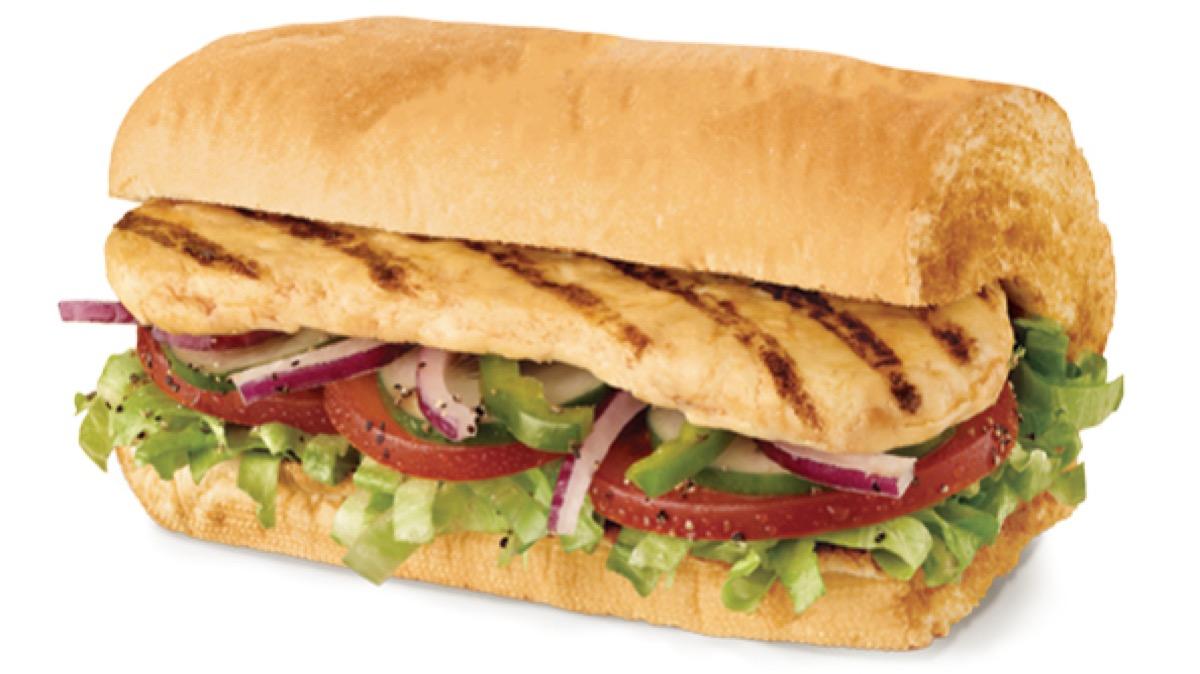 subway oven roasted chicken sandwich on white background