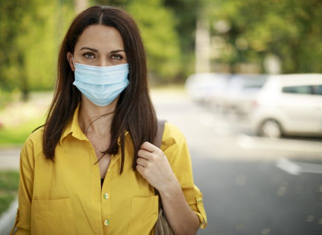 Woman with face protective mask outdoor
