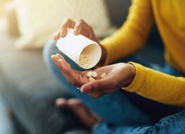 Woman taking medication at home