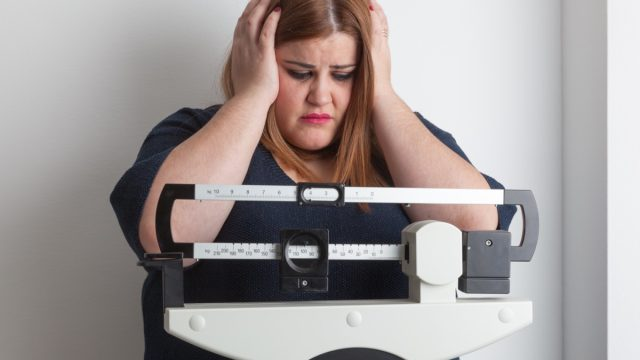 Woman obese scale
