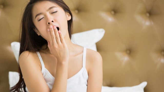Asian,Women,Are,Yawning,After,She,Wake,Up.
