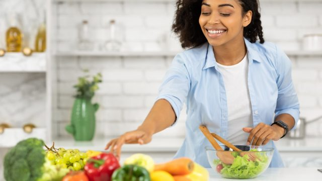 young woman making healthy meal