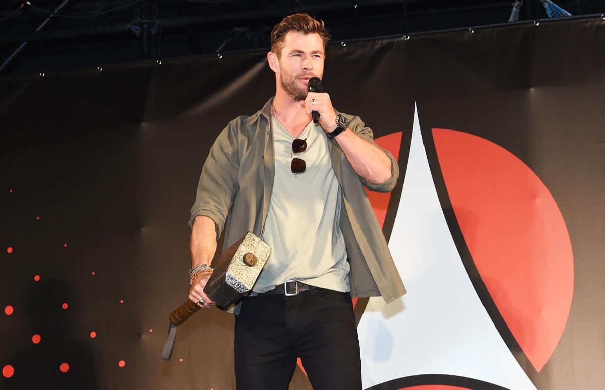 chris hemsworth holding thor's hammer