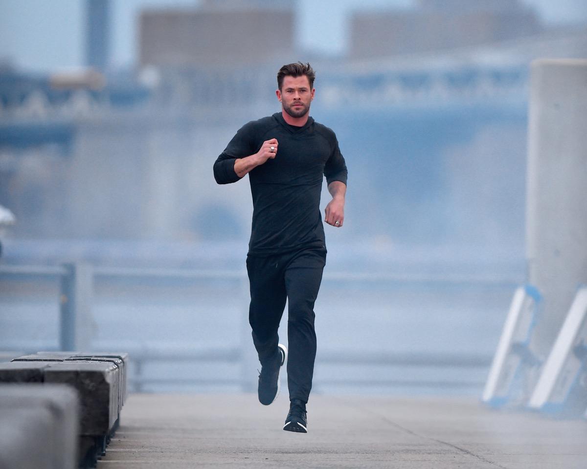 chris hemsworth running outdoors