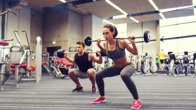 young couple lifting weights