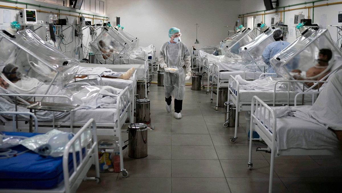 Medical staff work in the Intensive Care Unit (ICU) for COVID-19 multiple patients inside a hospital.