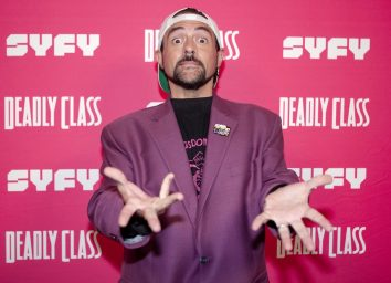 kevin smith in purple jacket making surprised face on red carpet