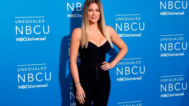 khloe kardashian in front of blue step-and-repeat at nbc universal upfronts