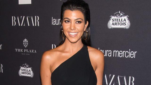 kourtney kardashian in black one shoulder dress